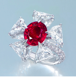 """A Superb Ruby and Diamond Ring, by Etcetera (Price realised USD 3,3457,042) - Sold by Christie's 29th May 2012, Hong Kong (Source:    www.christies.com   )    Designed as a flowerhead, centering on an oval-shaped ruby weighing approximately 6.04 carats, within a cushion-shaped diamond petal surround, mounted in 18K white gold, ring size 6    With maker's mark for Etcetera    Accompanied by report no. 59356 dated 3 May 2011 from the SSEF Swiss Gemmological Institute stating that the 6.04 carat ruby is of Burma (Myanmar) origin, with no indications of heating; also accompanied by an appendix stating that the ruby possesses extraordinary characteristics and merits special mention and appreciation. The ruby exhibits a well-saturated colour combined with an outstanding purity. The few inclusions found by microscopic inspection represent the hallmarks of the classical ruby mines in the Mogok valley in Burma (Myanmar). Its vivid and saturated red colour, poetically referred to """"pigeon's blood"""", is due to a combination of well-balanced trace elements in the stone. A natural ruby from Burma of this quality represents a great rarity and the described gemstone with its combination of outstanding characteristics is a very exceptional treasure  Also accompanied by report no. 11050003 dated 5 May 2011 from the Gübelin Gemmological Laboratory stating that the 6.04 carat ruby is of Burma (Myanmar) origin, with no indications of heating and this colour variety may also be called """"pigeon's blood red"""" in the trade; also accompanied by an appendix and note stating that Burma has long been recognized as the locality associated with the most desirable rubies in the world. Within Burma (now Myanmar), the most famed region is the Mogok Valley, or Mogok Stone Tract, in the Katha district, North East of Mandalay. These Mogok-type rubies typically possess a red body colour and red UV-fluorescence. In addition, they may contain tiny amounts of light-scattering rutile silk and a swirl-like grow"""