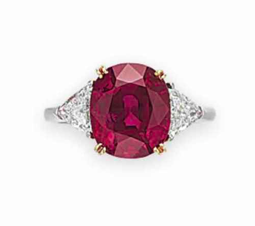A Ruby and Diamond Ring (Price realised 245,000 USD) - Sold by Christie's 10th December 2015, New York (   Source: www.christies.com)     Set with an oval-cut ruby, weighing approximately 4.76 carats, flanked on either side by a triangular-shaped diamond, ring size 5 1/2, mounted in platinum. Accompanied by report no. CS 71242 dated 29 October 2015 from the AGL American Gemological Laboratories stating that it is the opinion of the Laboratory that the origin of the ruby, weighing 4.76 carats, is Burma (Myanmar), with no heat enhancement.