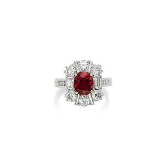 A Ruby and Diamond Ring (Price realised USD 127,564) - Sold by Christie's, 18th May 2016, Geneva. (   Source: www.christies.com   )    Set with an oval-cut ruby, weighing approximately 2.08 carats, between baguette-cut diamond shoulders, within a circular-cut diamond surround, ring size 6 ¾, mounted in platinum Accompanied by report no. 80426 dated 4 June 2015 from the SSEF Swiss Gemmological Institute stating that the origin of the ruby is Burma (Myanmar), with no indications of heating, and that the colour may also be called 'pigeon blood red'.