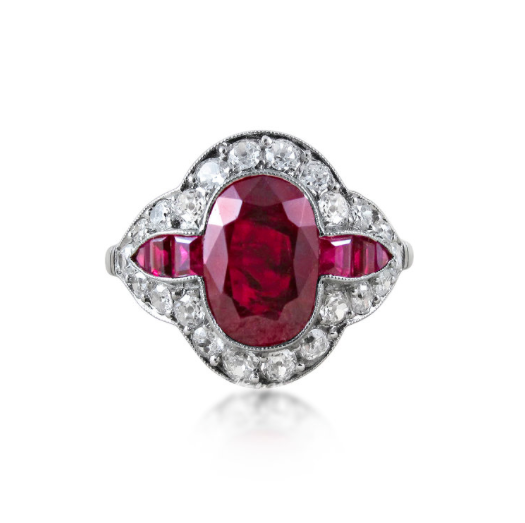 A Belle Epoque Style Burmese Ruby and Diamond Ring    (Available at www.revivaljewels.com)    Centering upon an oval-cut ruby of circa 2.57 carats within a surround of millegrain set circular-cut diamonds and baguette-cut rubies, mounted in platinum, size 54 (14).    With report no.    16050134    dated 24/05/2016 from the Gübelin Gemlab, stating that the ruby is from Burma (Myanmar) origin and that no indication of heating has been detected.