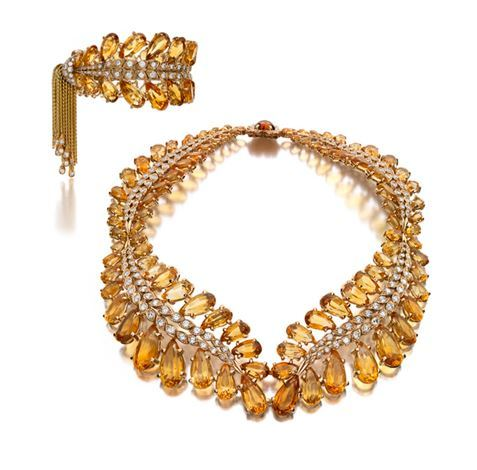 A Citrine, Diamond and Gold Demi-Parure, Pierre Sterlé.    Comprising a necklace and bracelet, the graduated necklace designed as a wreath of leaves set with pear-shaped citrines, the spines set with single-cut and round diamonds, the bracelet of similar design enhanced by a gold link tassel accented by round diamonds at the terminals; mounted in 18 karat yellow gold, with French assay marks.