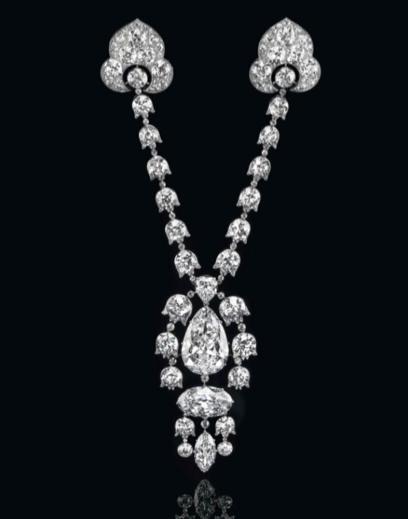 A Belle-Époque diamond devant-de-corsage mounted in platinum, by Cartier, with maker's mark for Henri Picq, photo courtesy of Christie's.