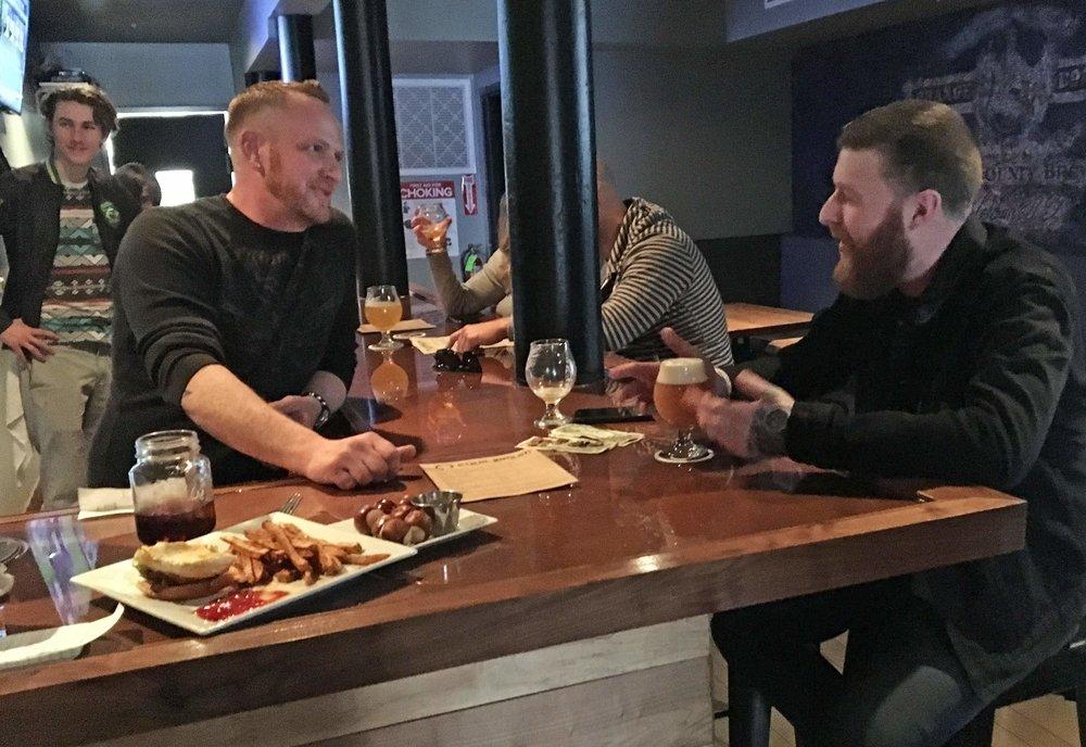 Equilibrium 2 guys at bar.png