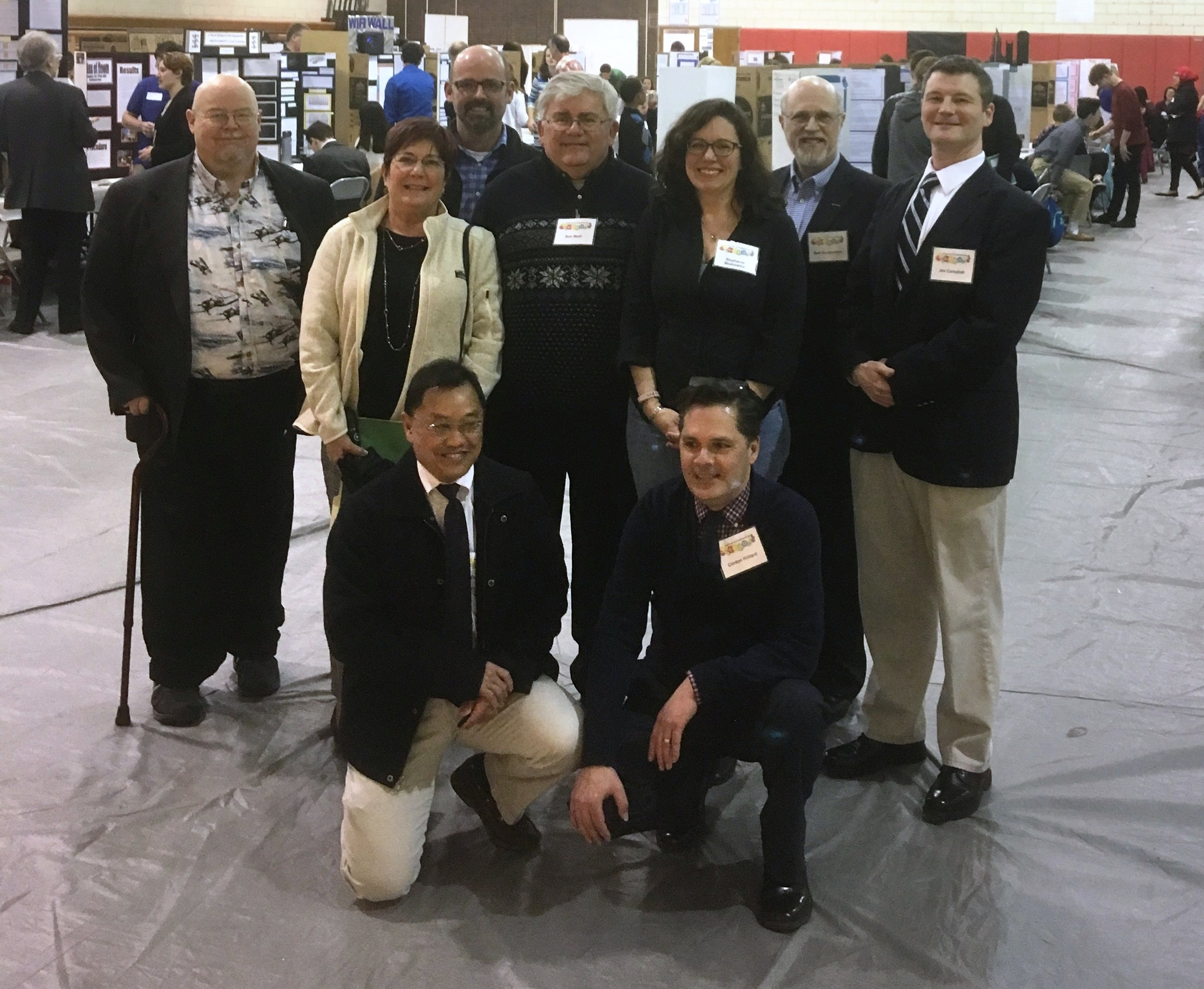 Figure 2 2019 Anne Arundel Expo Judging Team: Back row - Thom Platt, Christie Best, Peter Hoffensetz, Bob Muth, Stephanie Miskiewicz, Bob Koppelman, and Jim Campbell. Front row - Danny Yue and Clinton Hilliard