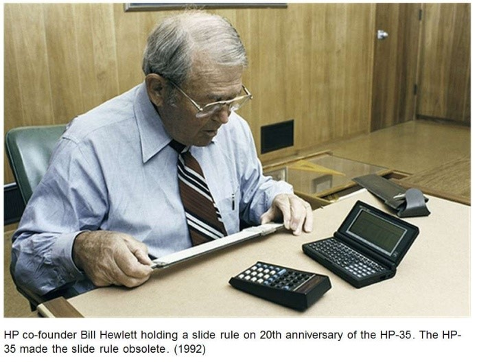 Figure 2, HP co-founder, Bill Hewlett, holding a slide rule on the 20th anniversary of the HP-35. The HP-35 made the slide rule obsolete.