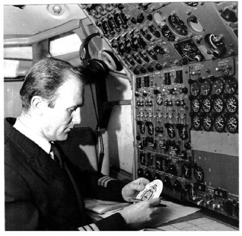 Boeing 707 Flight engineer with circular slide rule