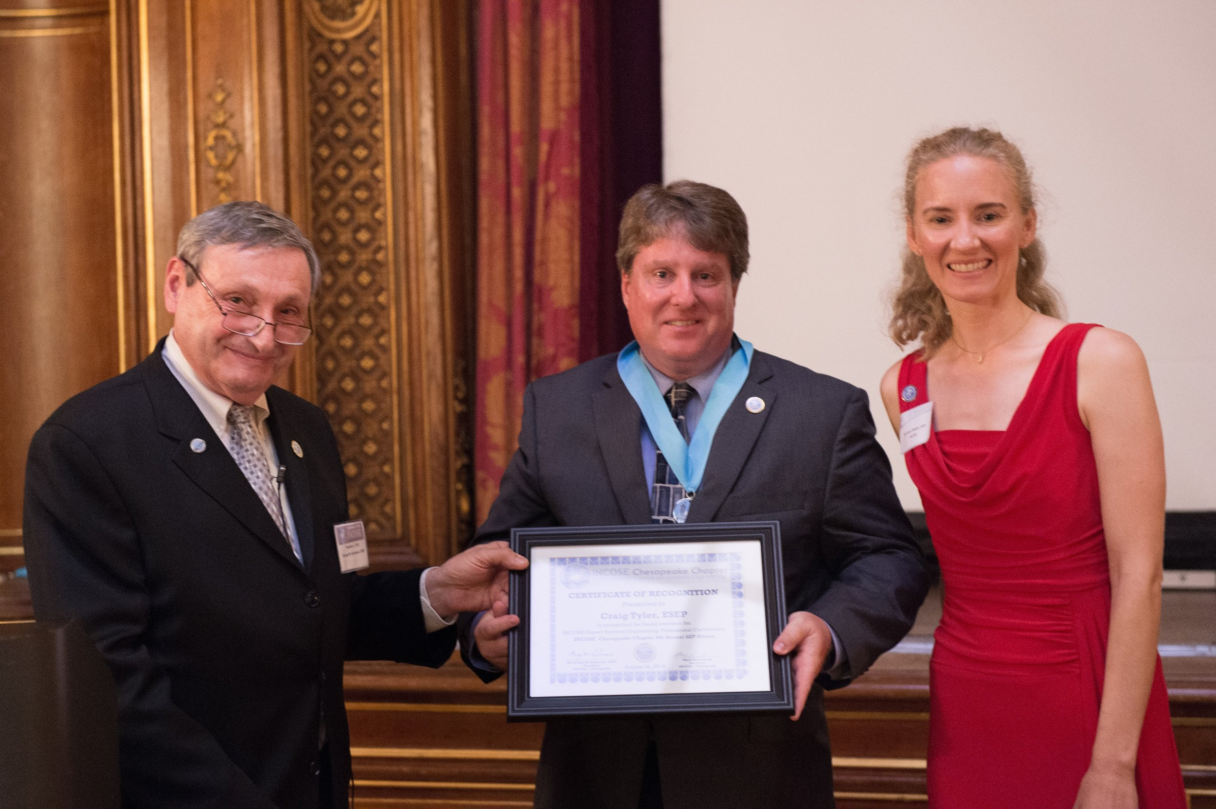 Craig Tyler receives his ESEP Recognition Certificate from George Anderson and Courtney Wright