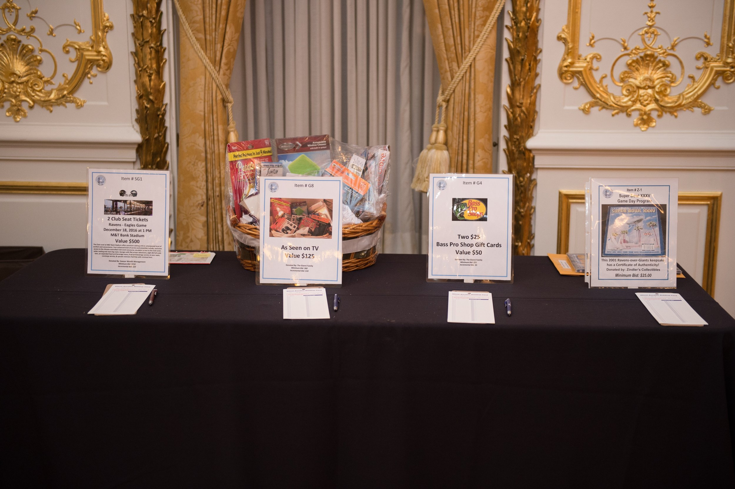 "Items available at the Silent Auction included Ravens Tickets, an ""As Seen on TV"" Gift Basket, Bass Pro Shop Gift Cards, and a Super Bowl Game Day Program"
