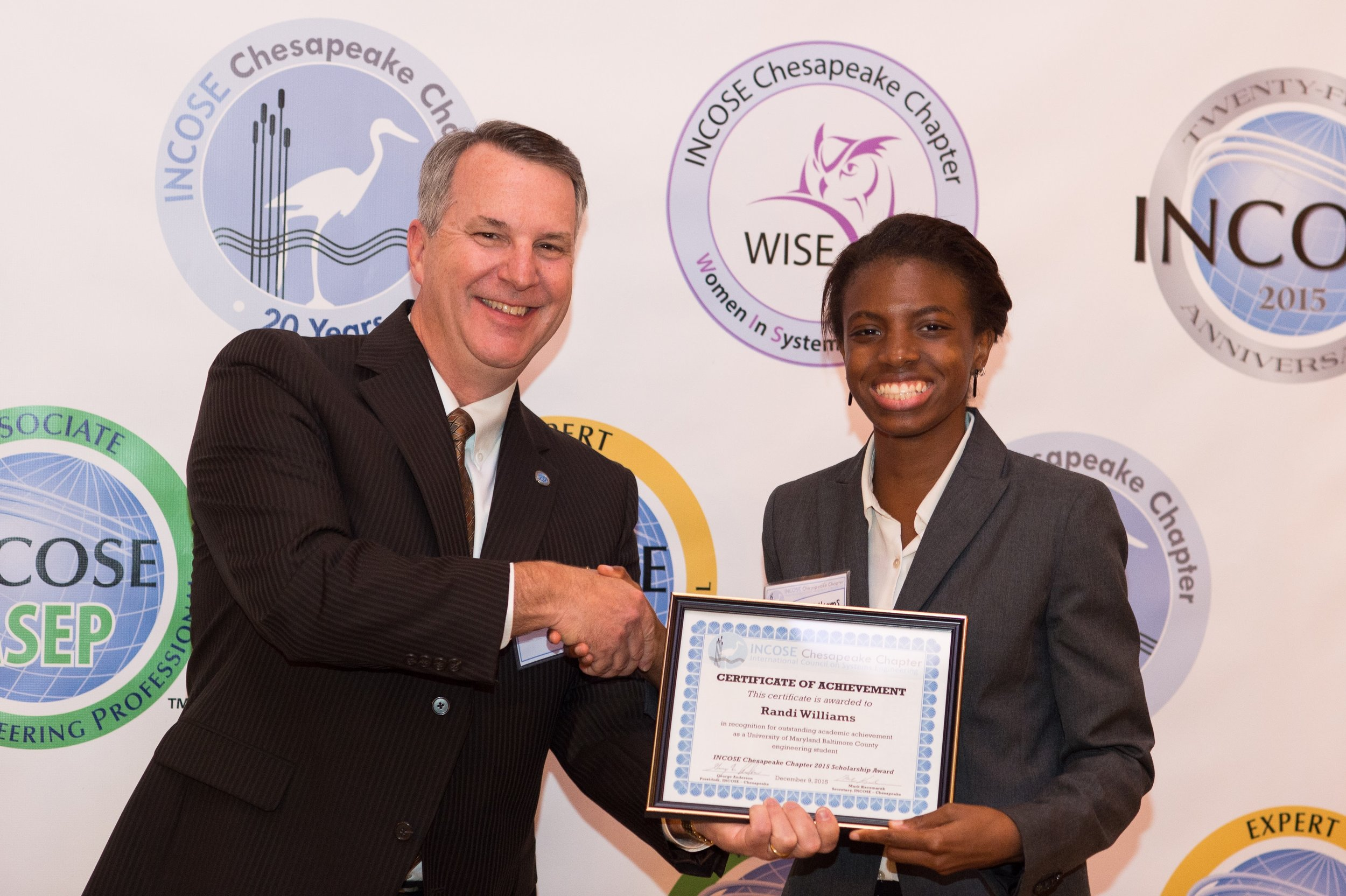 Randi Williams, University of Maryland Baltimore County (UMBC) receives a scholarship award from the Chesapeake Chapter and Chairman of the Scholarship Committee, Bob Levin.