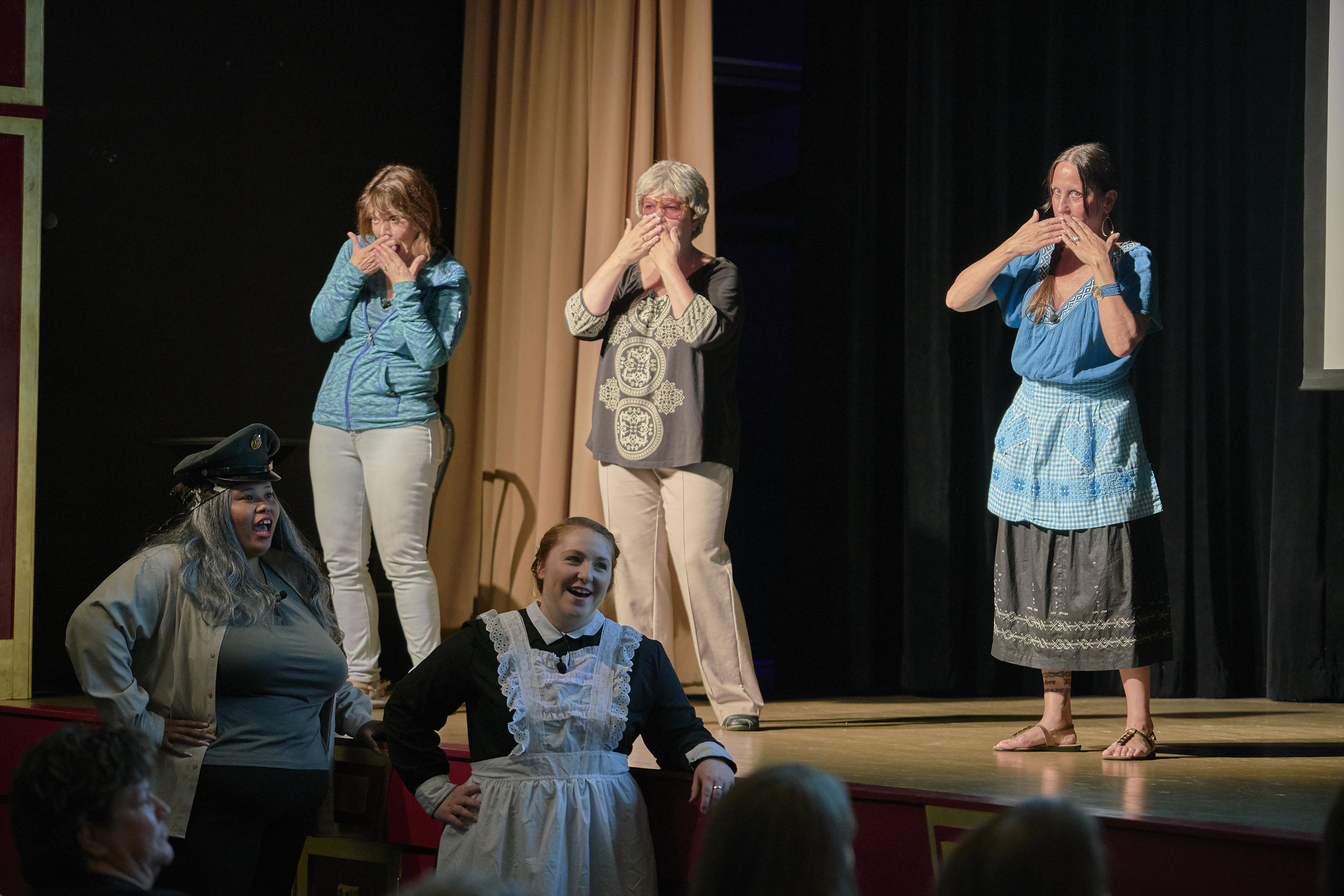 "L to R on stage, Nancy Horrell as Narrator, Kathy Metzger as Lucille Hamons, and Cindy Conner as Lucia Rodriguez; and L to R below stage, Brittany Ann-Marie Taylor as Carmen, a WAC, and Brittany Roper as Margaret, a Harvey Girl, all know ""when to suck it up"" in the original song, ""Making Good in a Man's World,"" the finale to Act One in the Pontiac production June 22-23. (Photo by Mitchell T. Fransen, courtesy of the City of Pontiac.)"