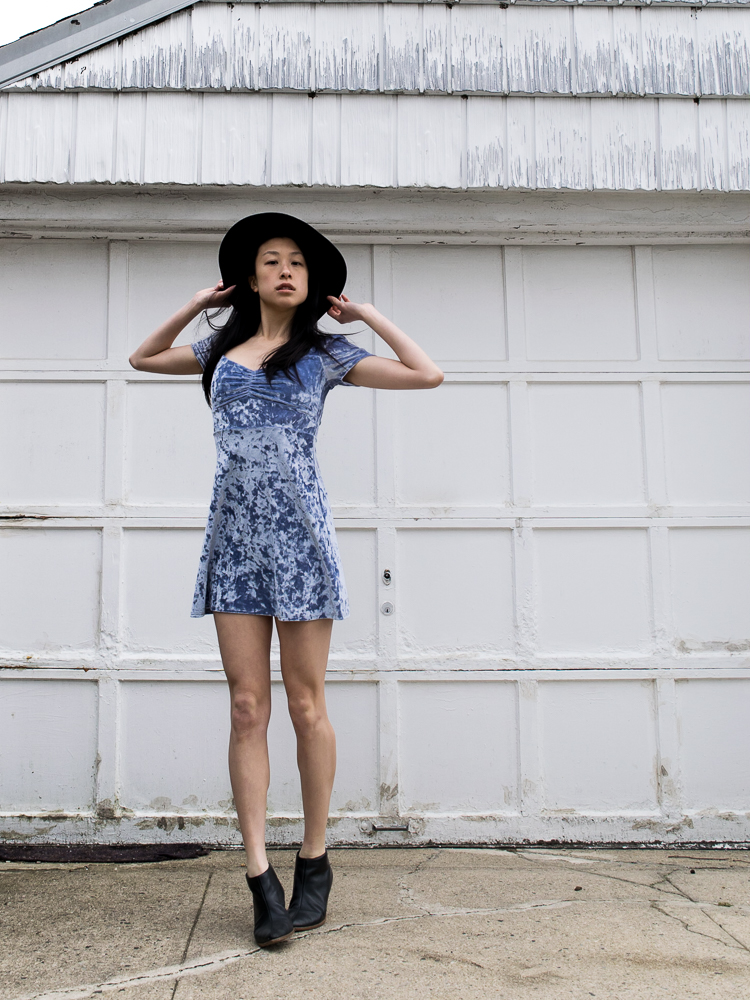 Female, East-Asian Style Blogger in Periwinkle Crushed Velvet Summer Dress with Black hat and black boots
