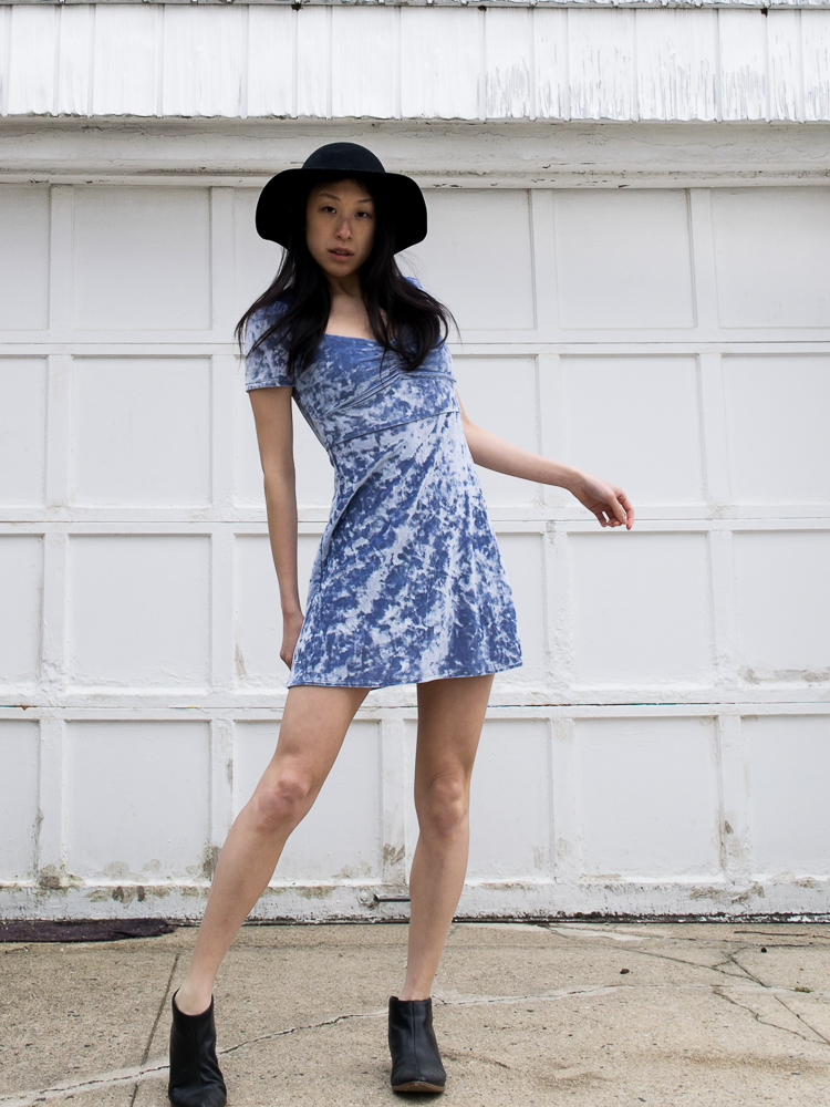 Young, Female East Asian Blogger in Periwinkle Crushed Velvet Summer Dress with Black hat and black shoes