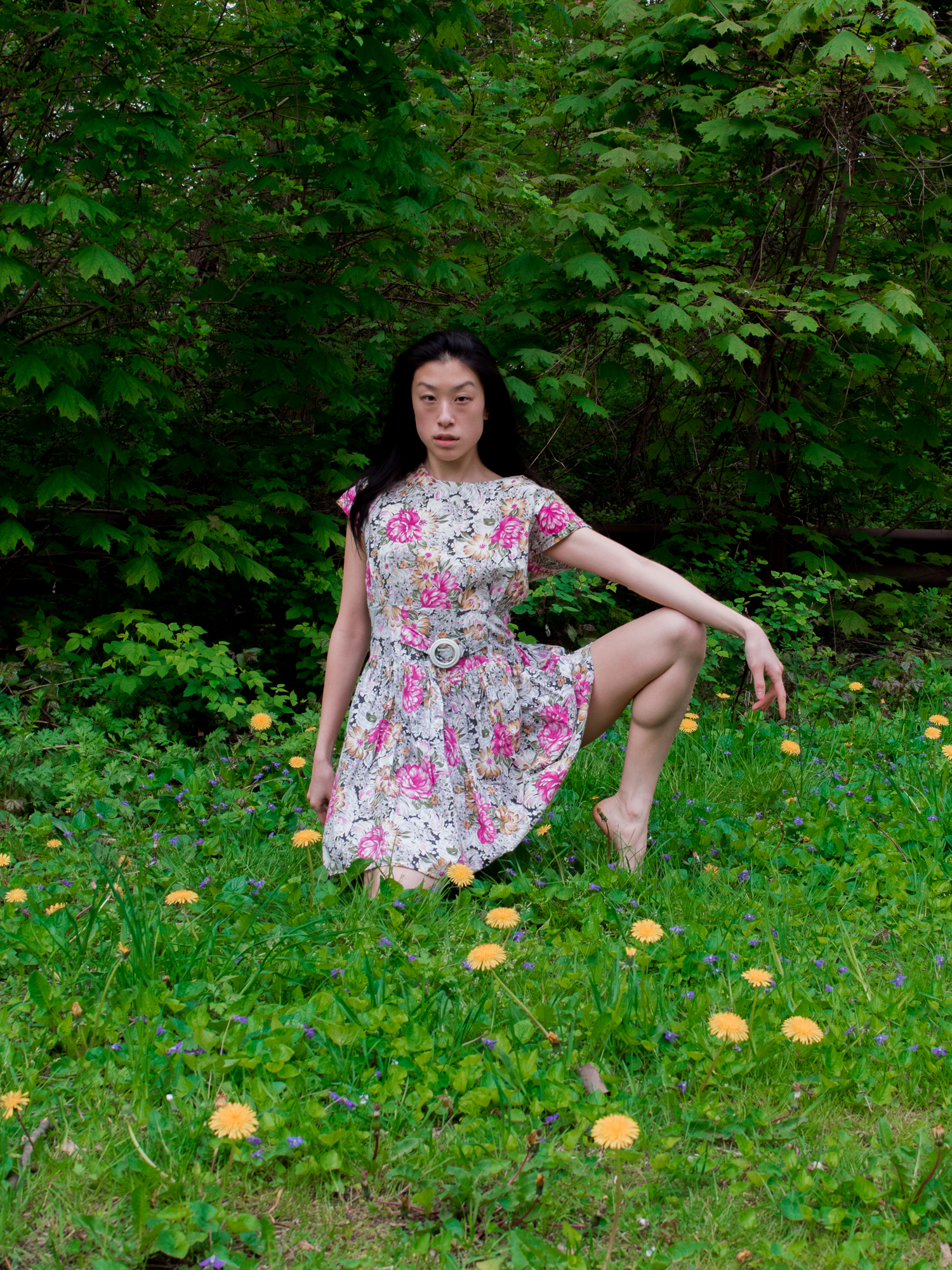 Female east asian blogger in pink, 1950s floral vintage dress