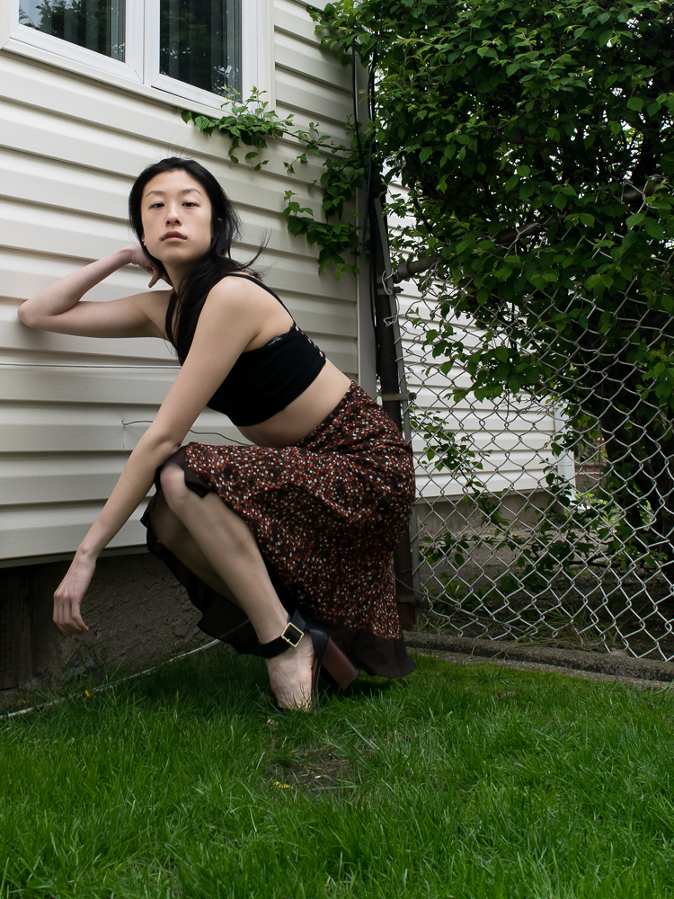 east asian female style blogger in Brown polkadot skirt, black crop top