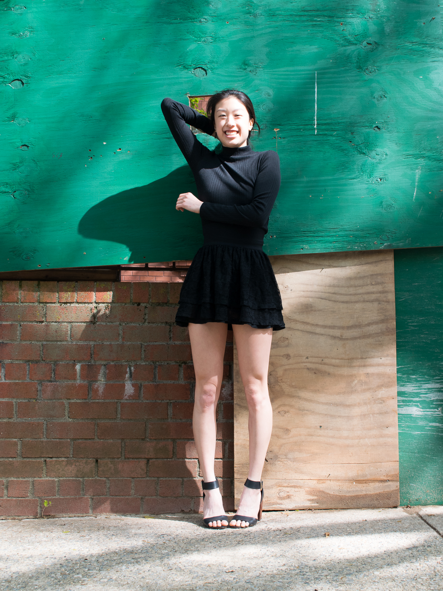 east asian female style blogger wearing all-black kpop-inspired pop punk outfit