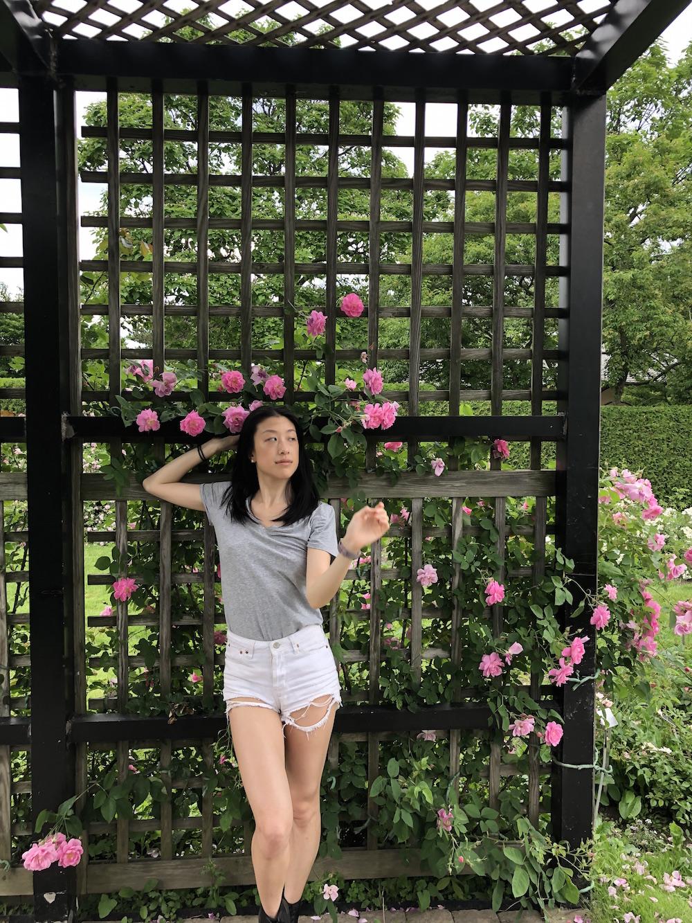 Gi Shieh wearing grey shirt white shorts in Montreal Botanical Gardens rose garden