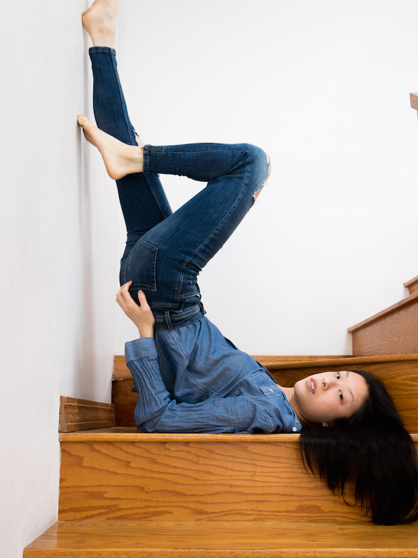 Female East asian style blogger wearing all blue denim outfit in shoulder stand