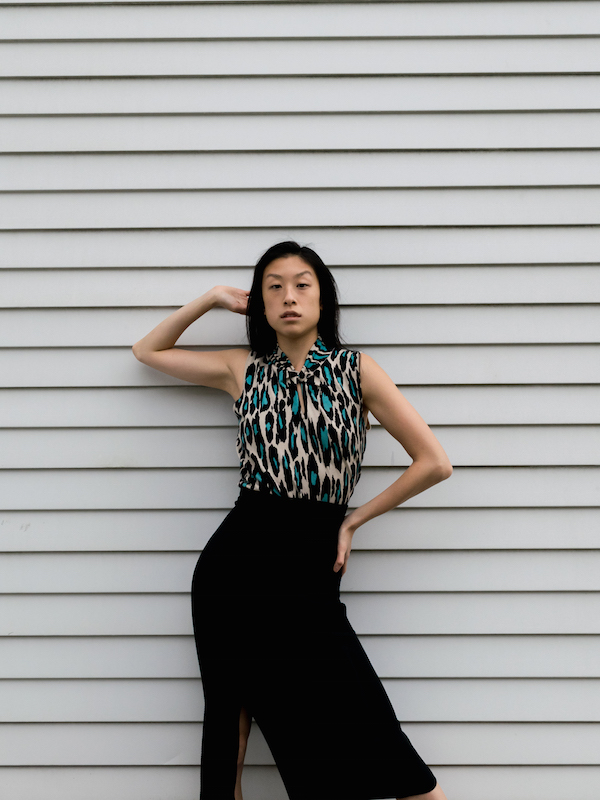 Gi Shieh sustainable style blogger wearing blue leopard keyhole knit top and black skirt