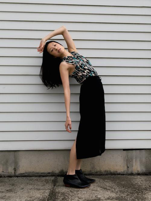 Gi Shieh wearing blue leopard print top and long black skirt