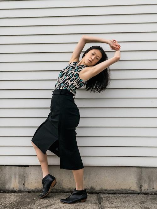 Gi Shieh Wearing Blue Leopard Print and Black Skirt