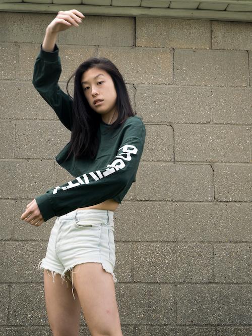 Outfit 2, positive green shirt, denim shorts