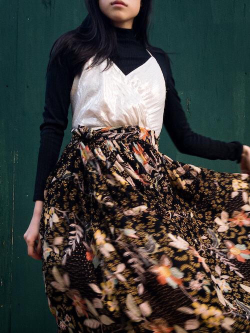Black turtleneck, silver gold dress, floral skirt details