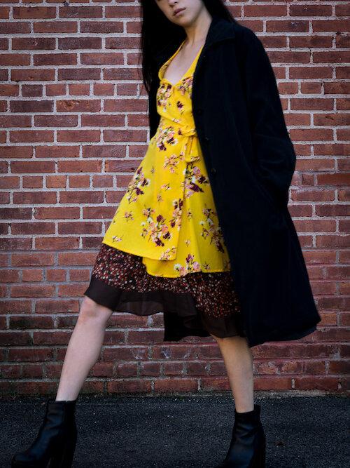 Yellow floral wrap dress, brown polka dot skirt, black trench Details