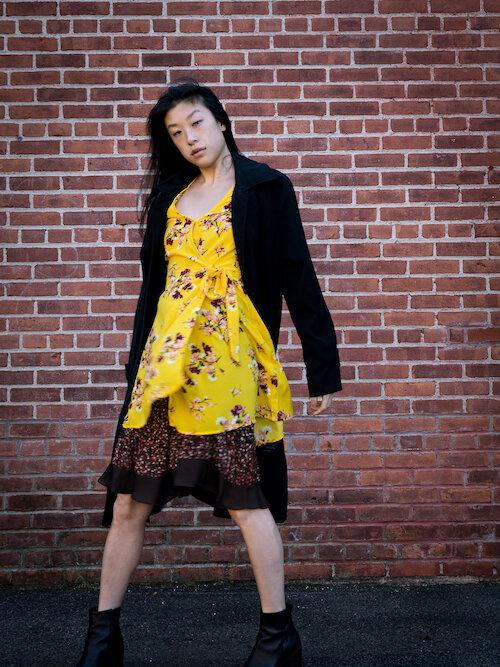Yellow floral wrap dress, brown polka dot skirt, black trench