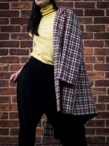 plaid overcoat, yellow turtleneck tee, black harem pants, black platform boots