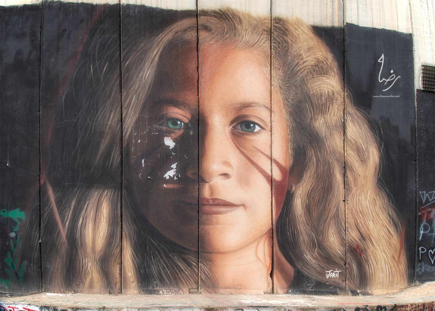 In July 2018, Israeli troops arrested and deported two Italian artists for painting this mural of Ahed Tamimi.