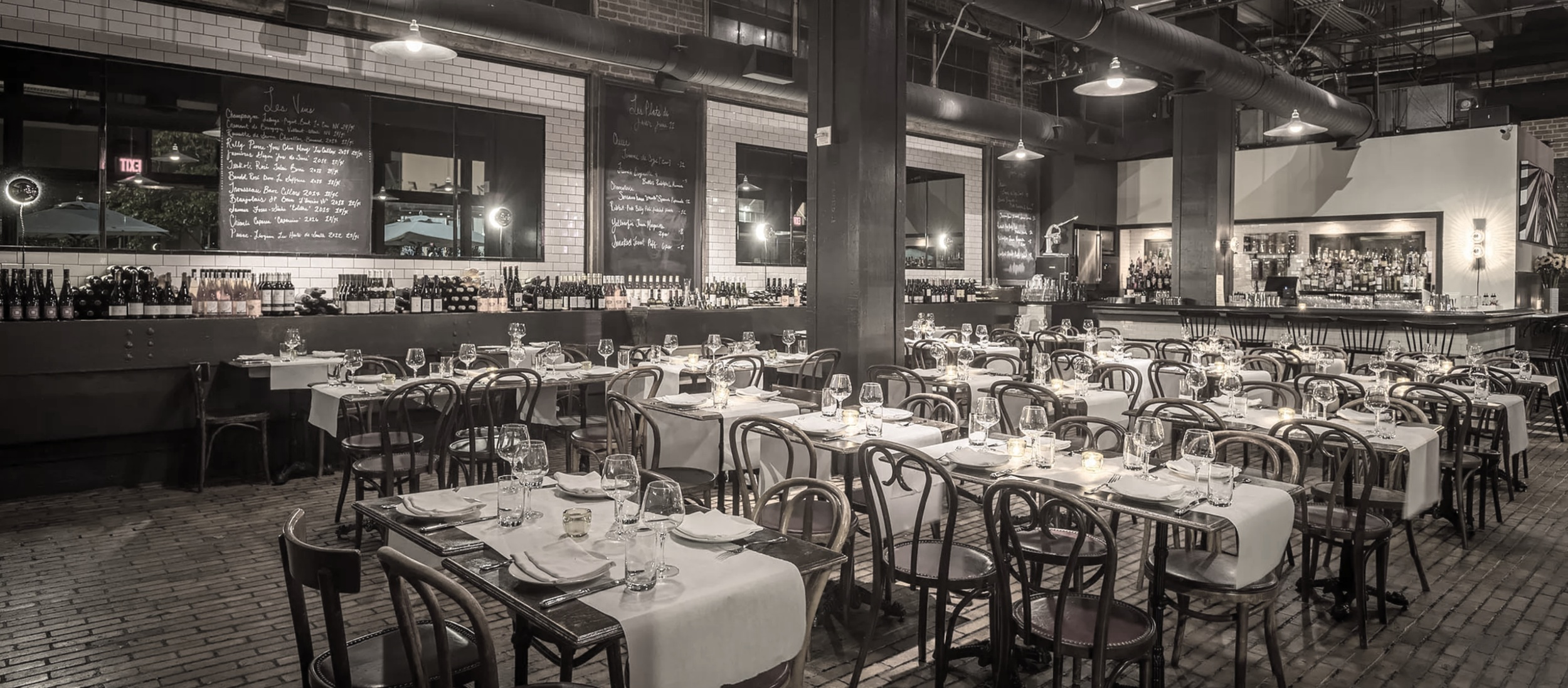 Soak In the Dark Parisian Bistro Vibes at the Newest Version of Church & State -
