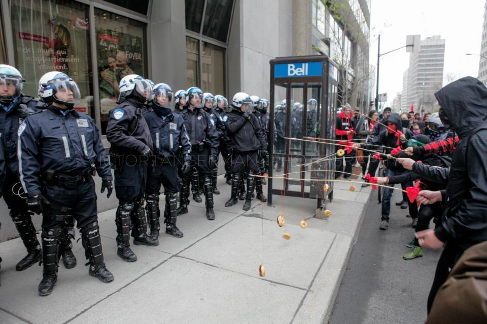 kingofrim :     Montreal student protesters baiting riot police with donuts.