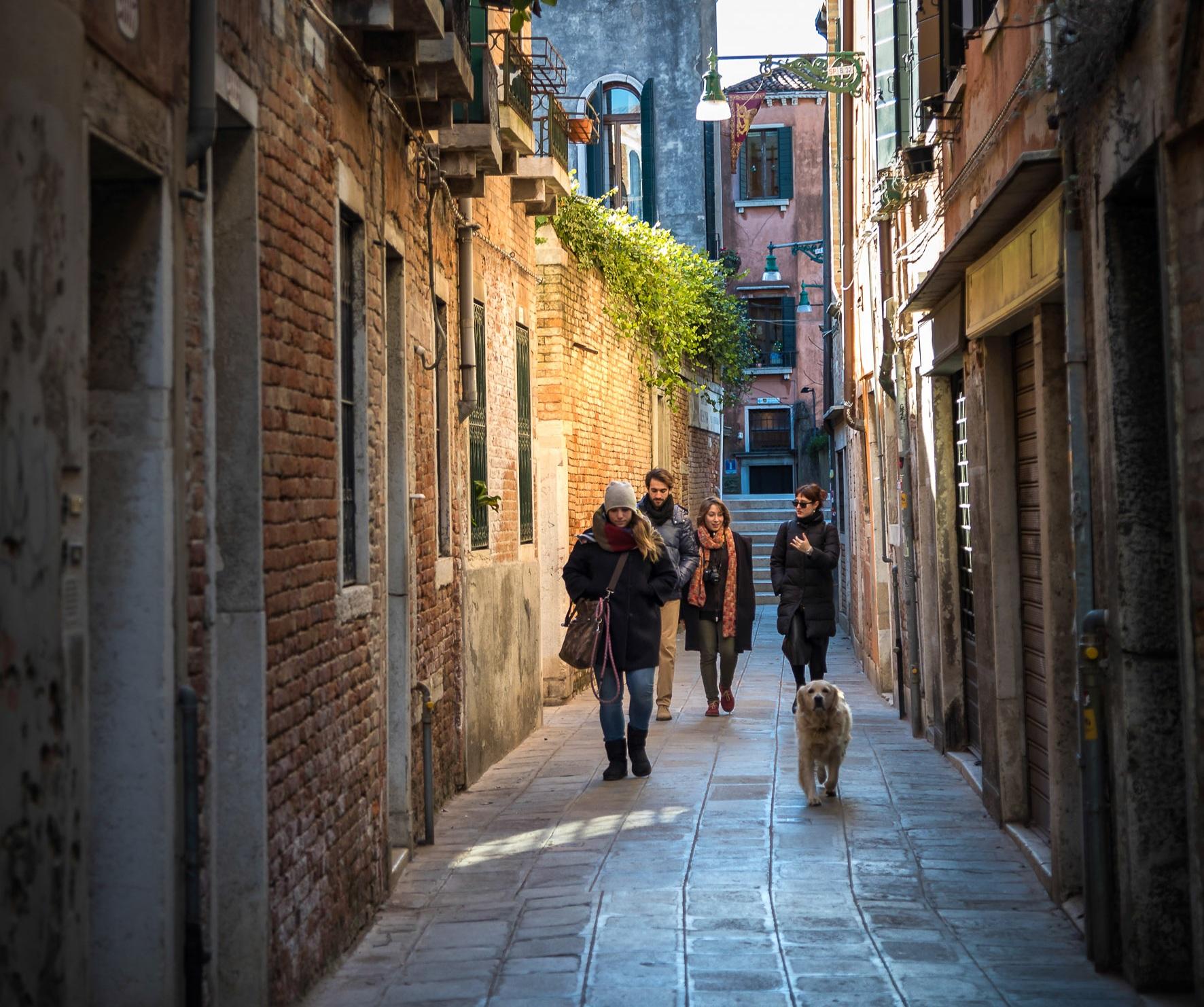 Travelers inside Venice lanes