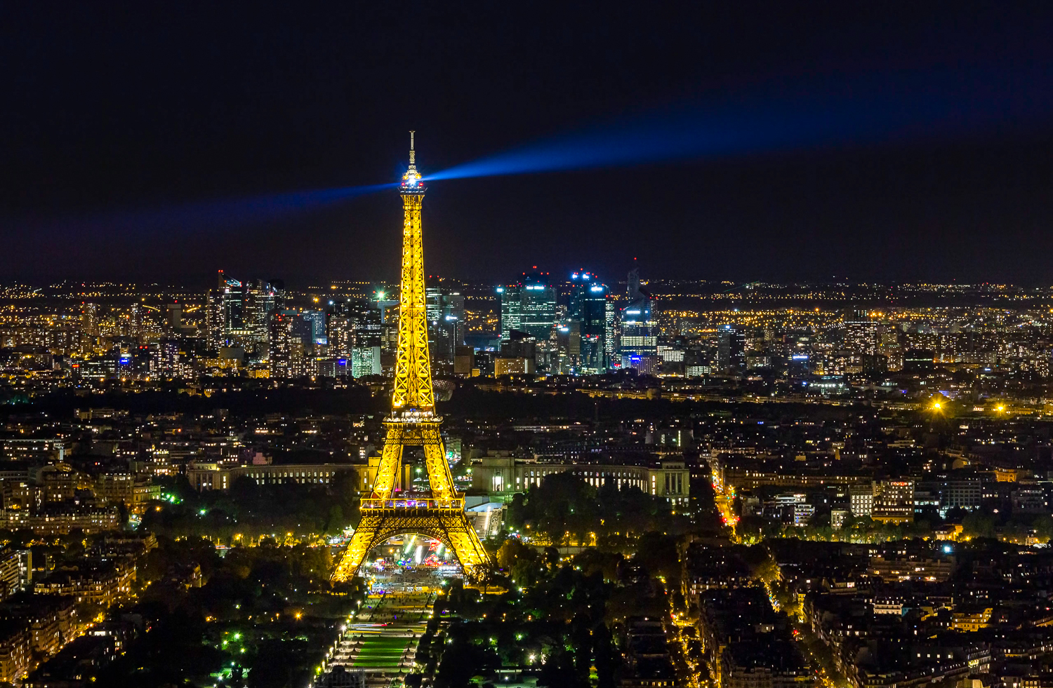 Eiffel Tower in Paris at night in city lights