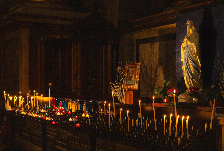 Candles inside la Madeleine in Paris