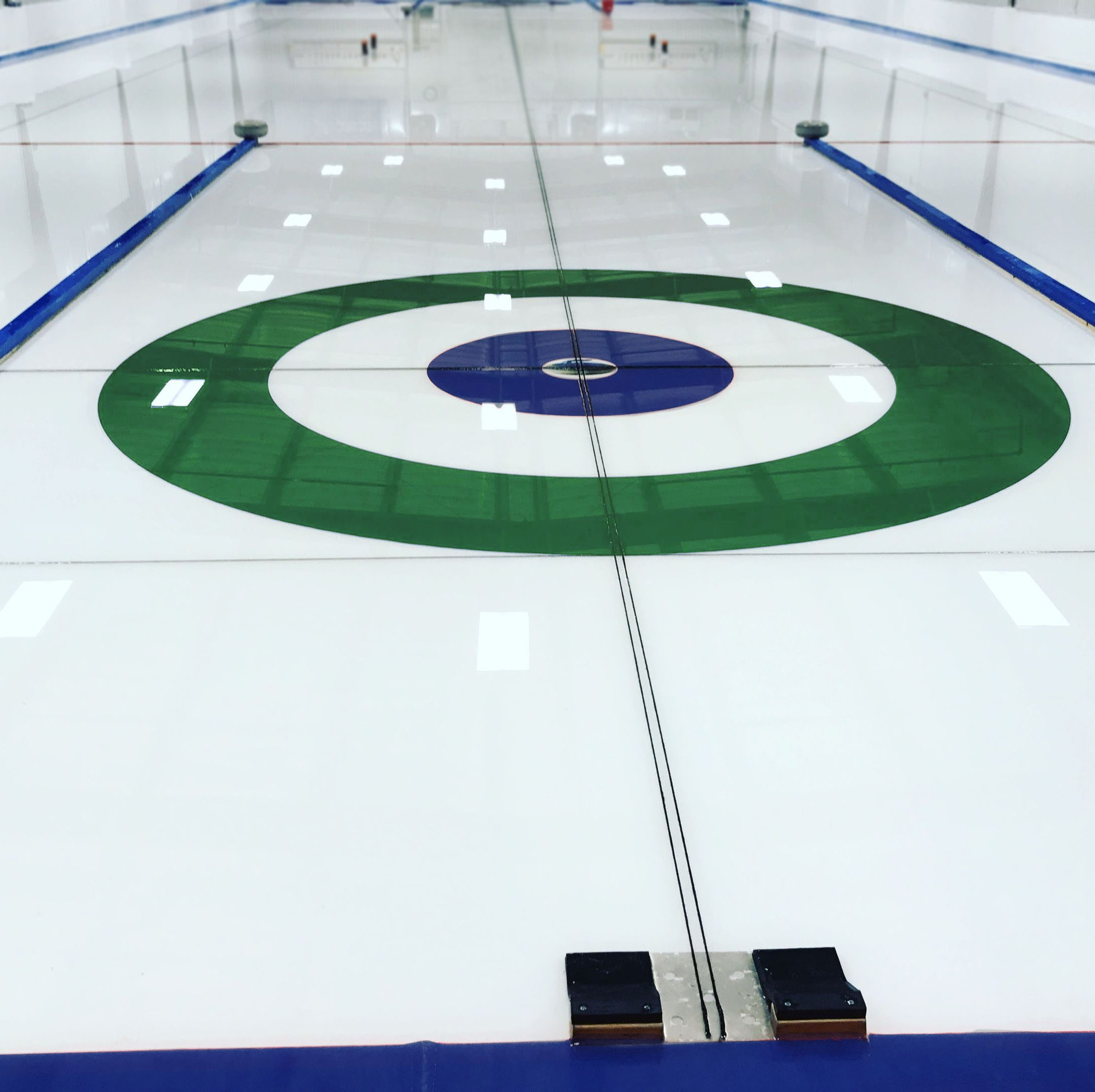 Inclusive Community Curling - Located in Maple City, the Leelanau Curling Club provides northwestern Michigan's only dedicated curling facility open year-round. Try curling at one of our frequent Learn-To-Curl events, join the League for fun weekly play, book a group event or grab a bite and something to drink and just watch the action! We can't wait to see you on the ice!Book a Learn to Curl Class ➝