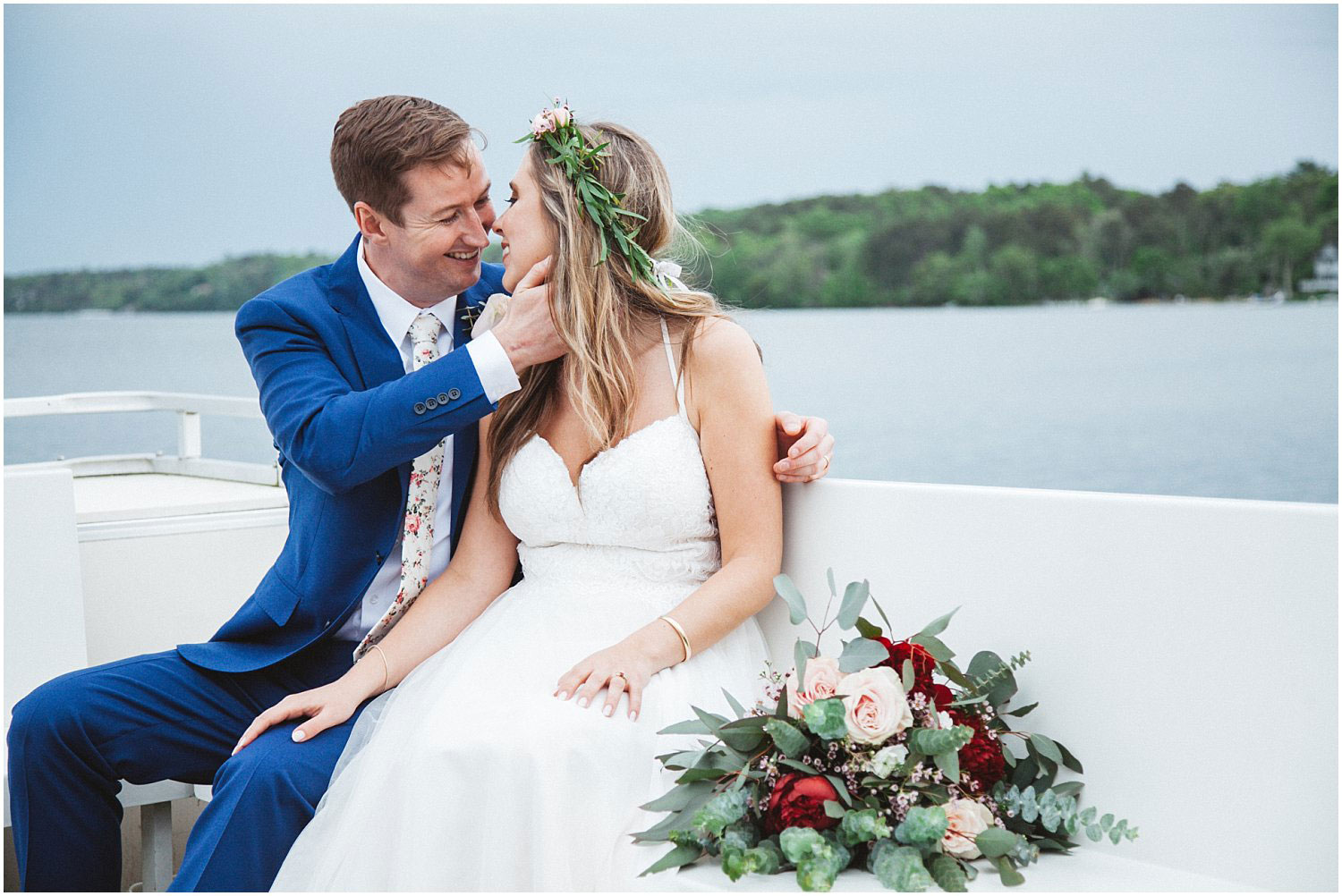 Bride and Groom on a boat in a lake at a wedding at Camp Bournedale in Plymouth, Massachusetts taken by Nicole Chaput Photography