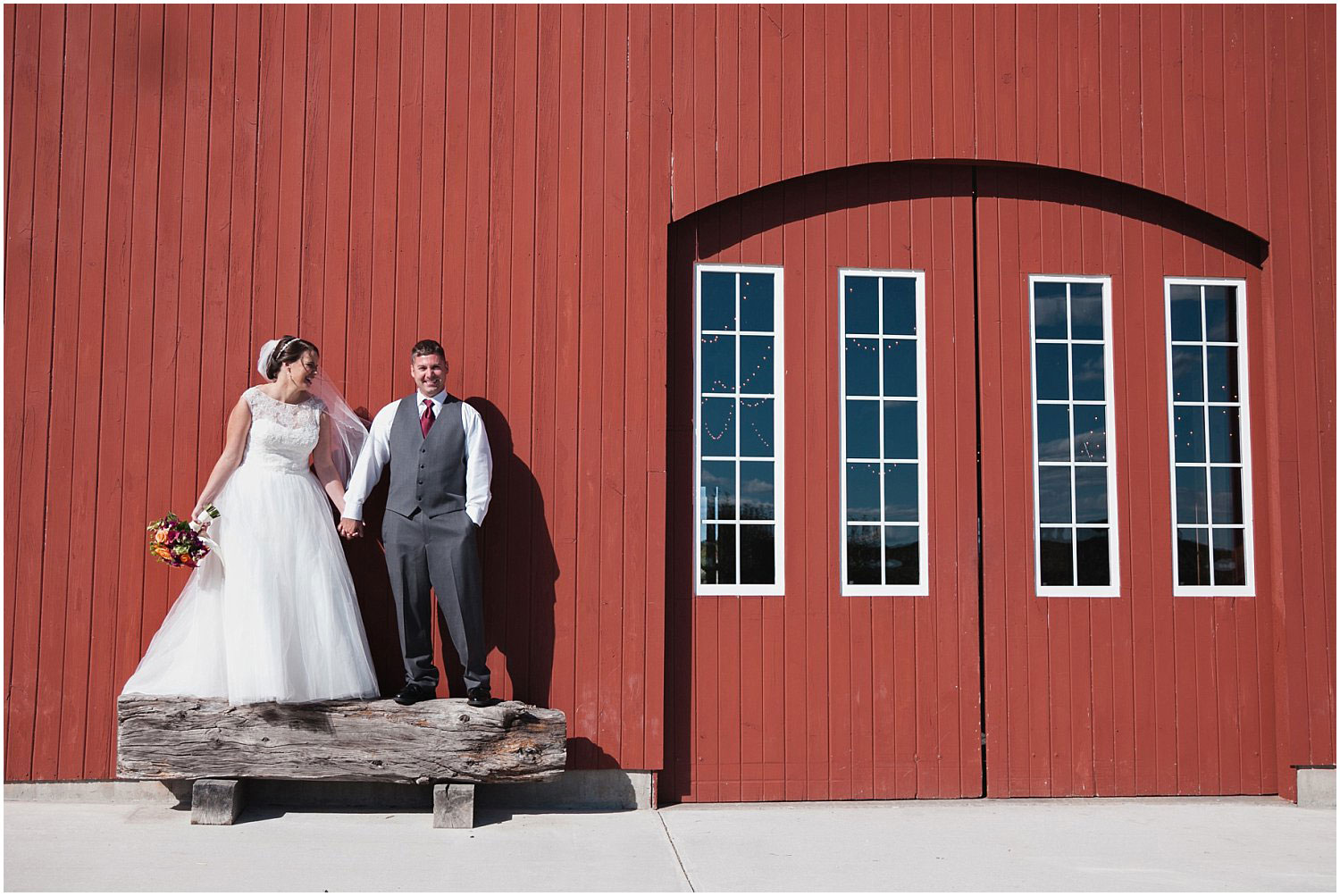 Bride and Groom in front of the red barn at a wedding at Allen Hill Farm in Brooklyn, Connecticut taken by Nicole Chaput Photography