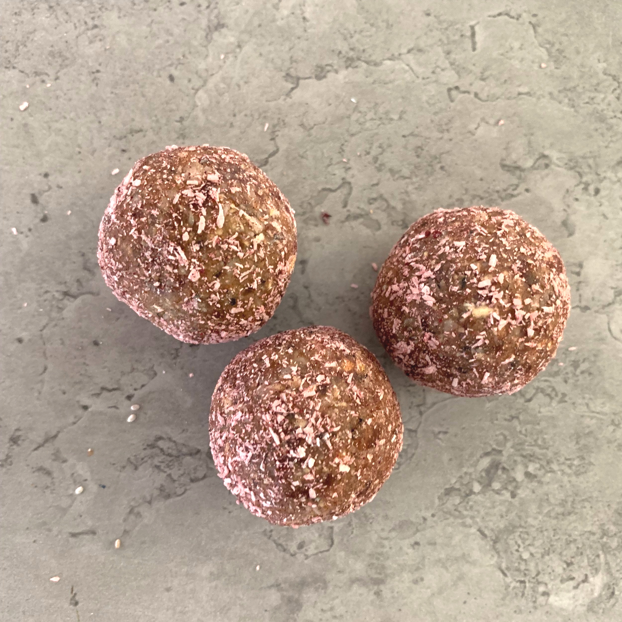 CARDAMOM BLISS BALL Ingredients: Oat  (gluten free), sunflower seeds, dates, cardamom, coconut cream, coconut, beetroot powder, salt