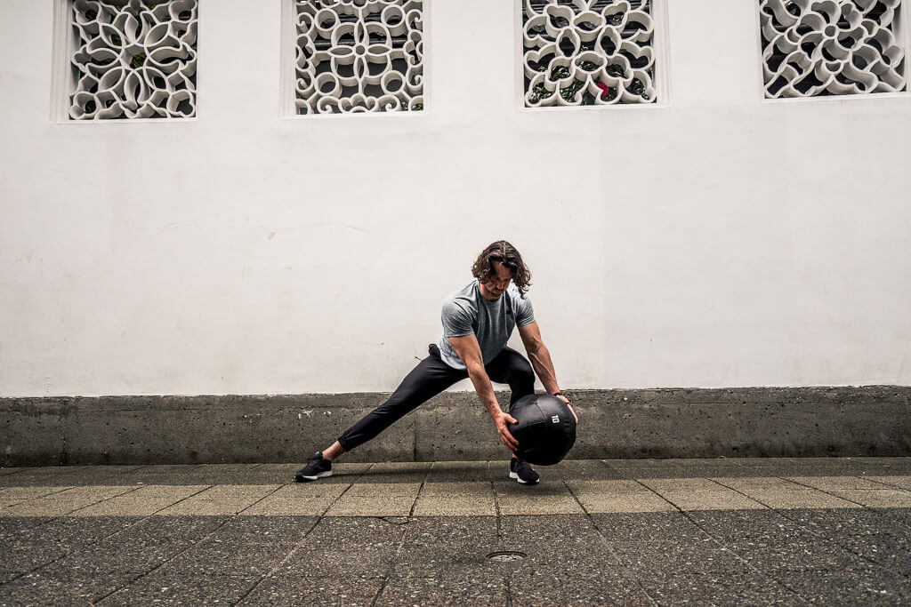 Medicine Ball Wood Chops Hold the ball in locked out arms  Rotate the ball in fully locked out arms from your foot to the opposite arm and back  Repeat on the opposite foot