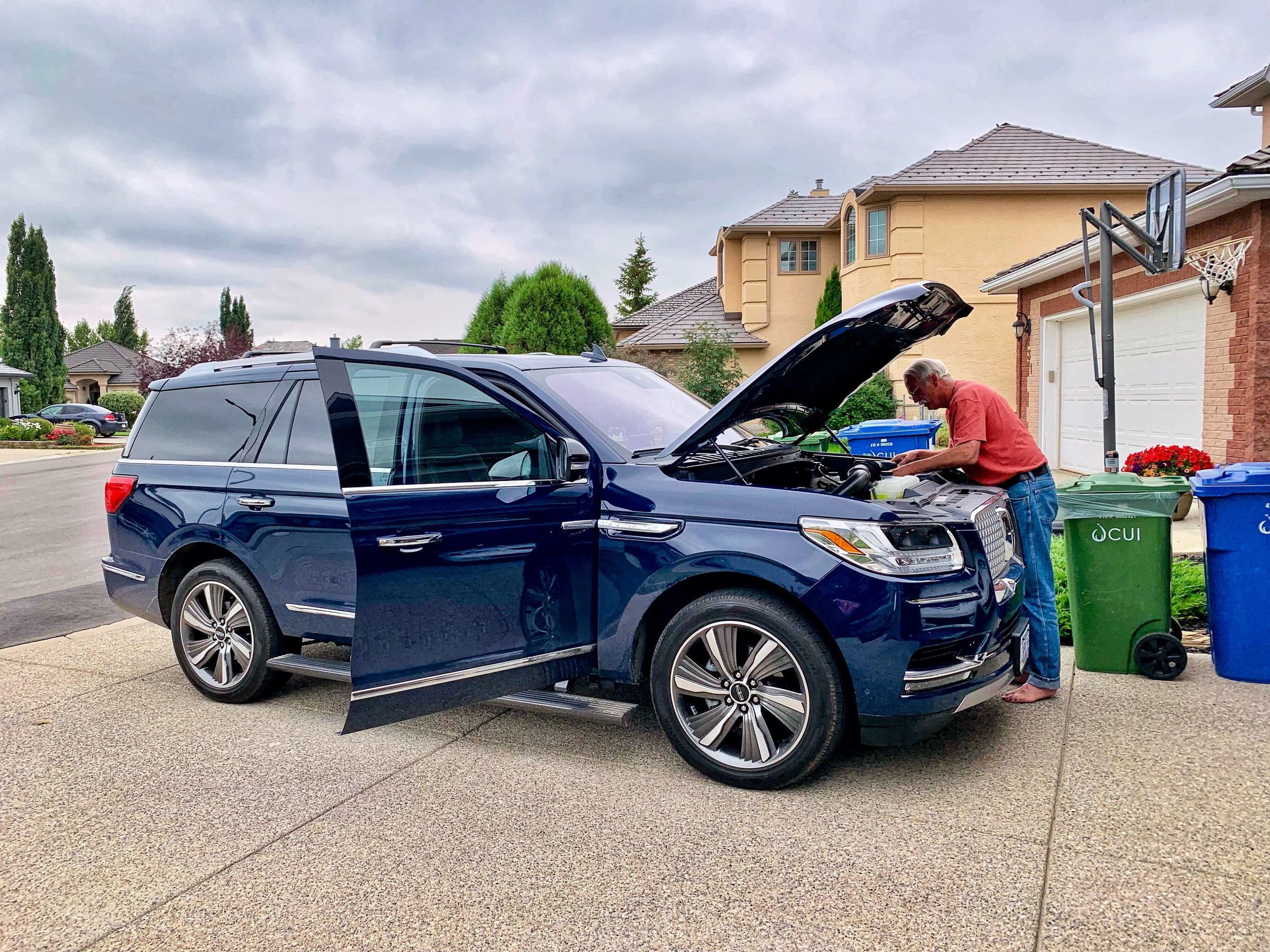 Uncle Dave checking out whats underneath the hood of the 2019 Navigator