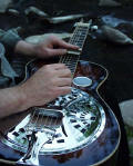 A real Dobro - The aluminum resonator is under the chrome circular device on the face of the guitar.