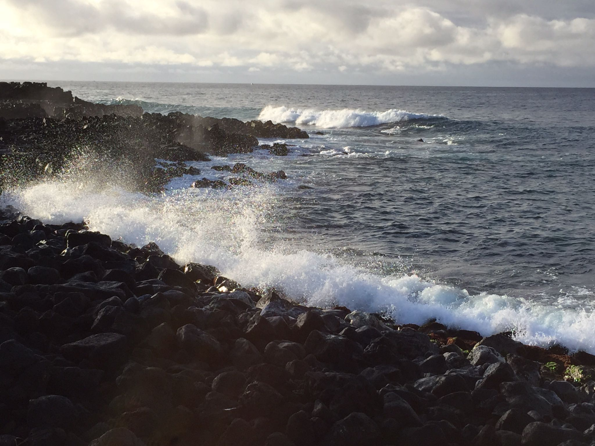 - Look at this picture.What draws your eye the most - the waves or the rocks?