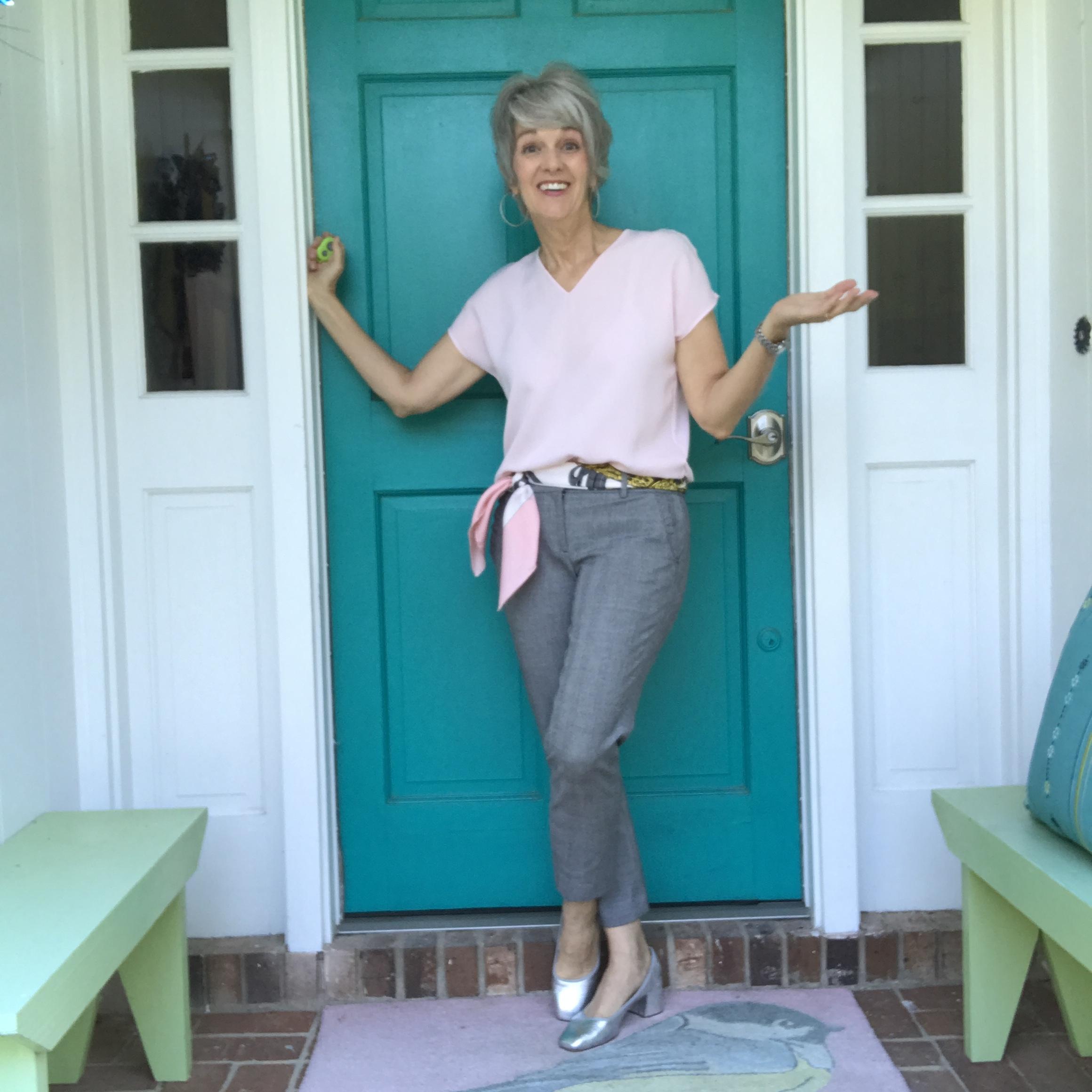 - Wear a Pink Accessory, like Liz' scarf worn as a belt.