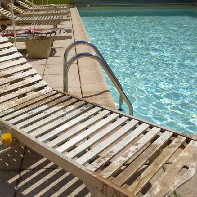Teak loungers by the Pool.jpg
