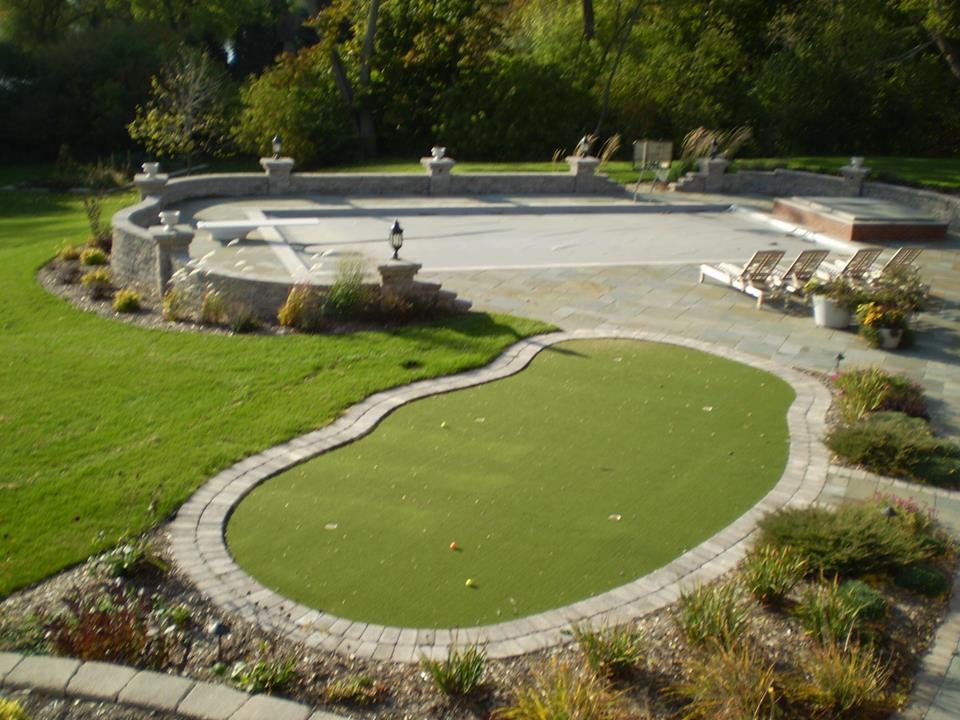 Vosters Landscaping | Plants | Shrubs | Landscape design | Putting green | Pool Deck | Brick