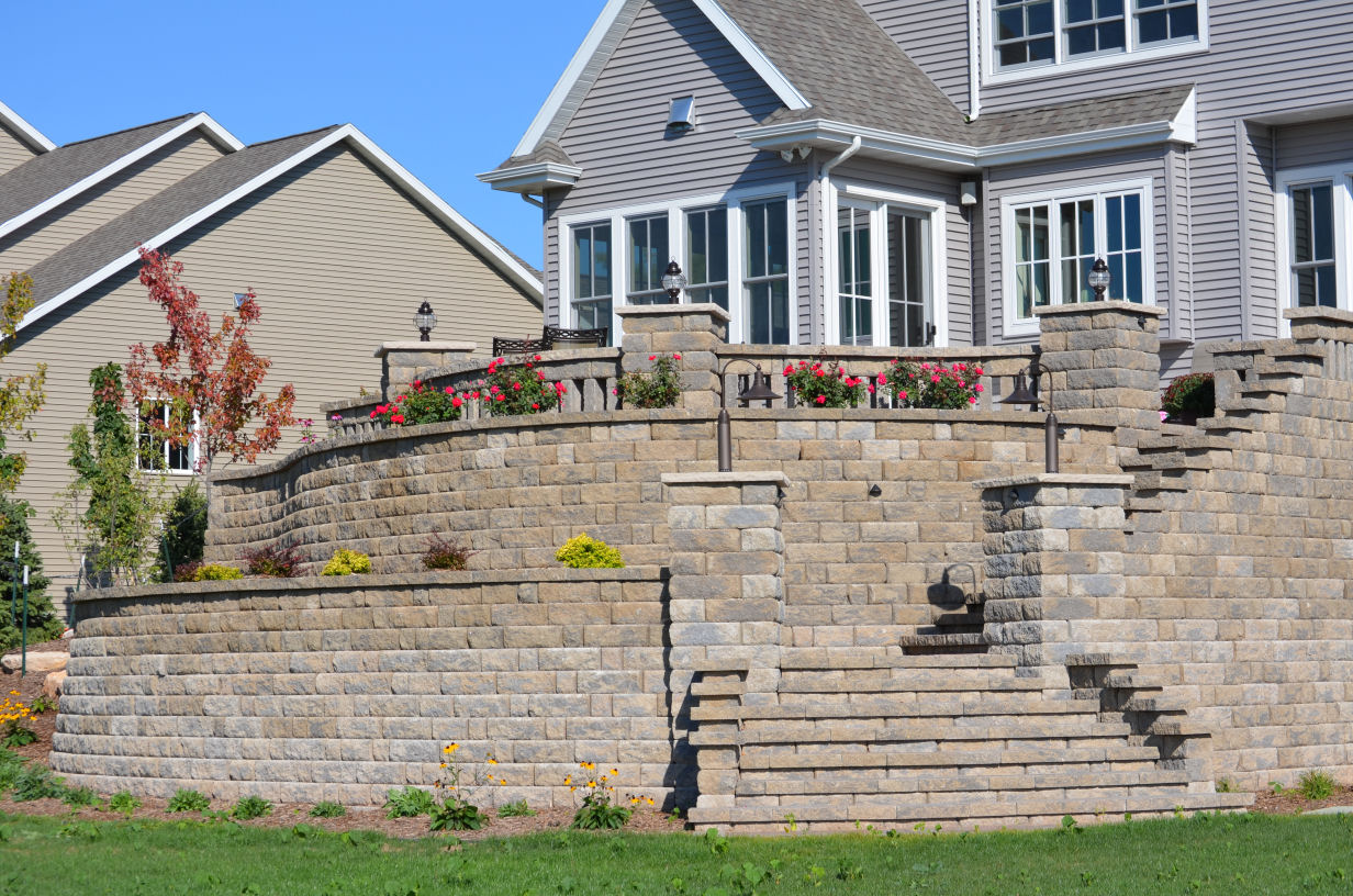 Vosters Landscaping | Brick | Hardscape | Outdoor Living | Patio | Paver Stairs | Retaining Wall