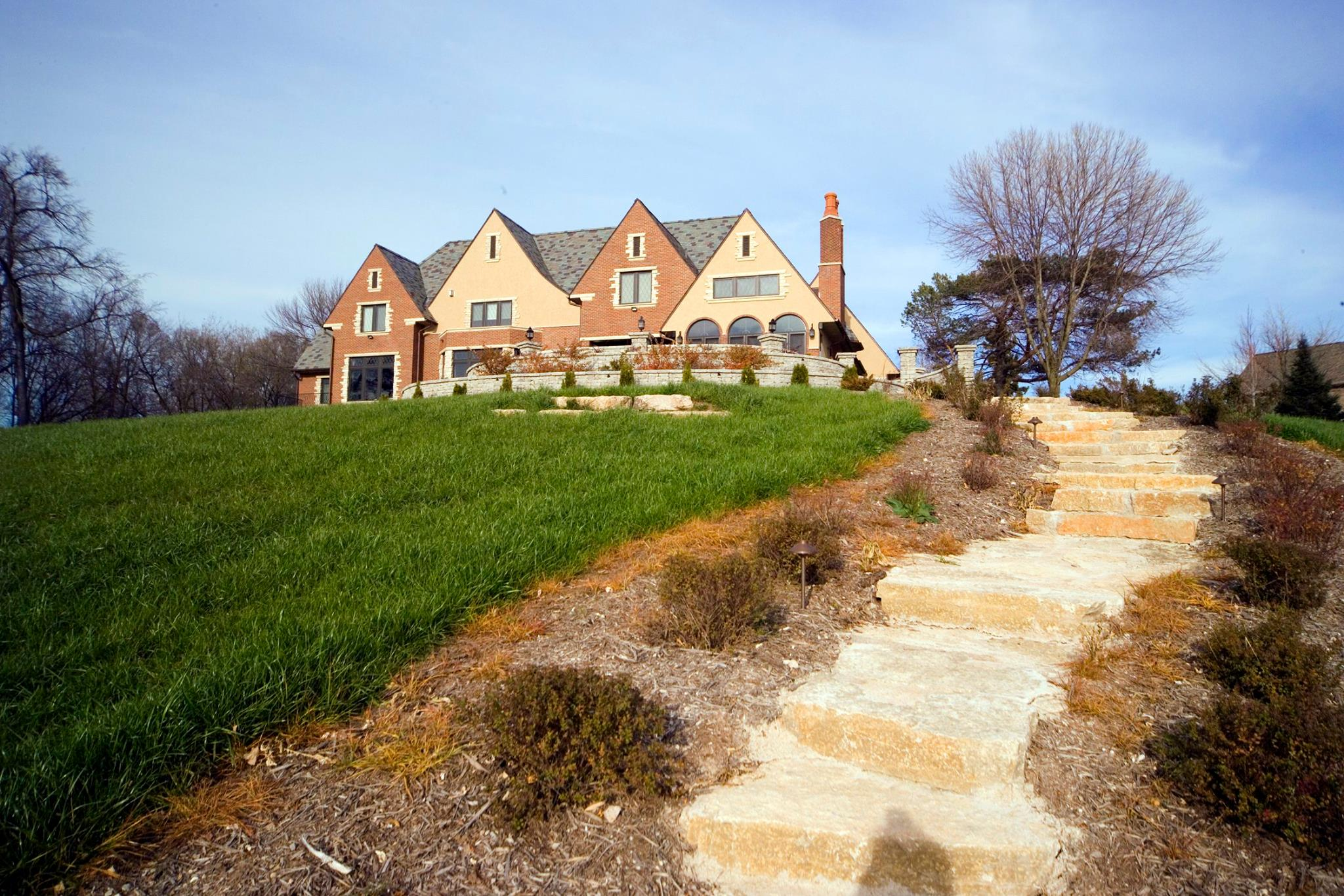 Vosters Landscaping | Landscape design | Maintenance | Shrubs | Plants | Trees | Paver Stairs