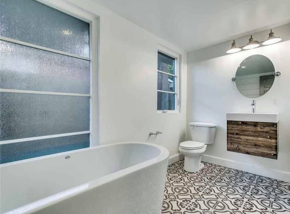 Remodeled Bathroom with unique tile
