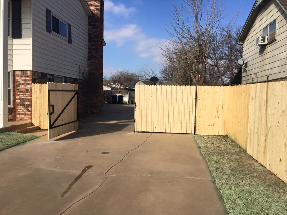 fence on driveway in Oklahoma City home